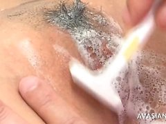 Asian lady gets her hairy pussy shaved