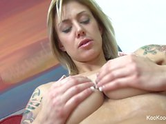 Blonde Jenny rubs lotion on her sexy big tits