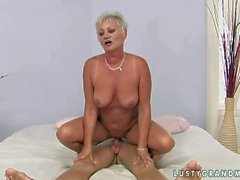 Short haired granny sucks young buck and gets nailed