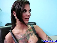 Tattooed lez squirter assfucked with strapon