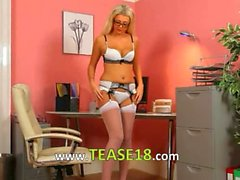 Secretary in sexy lingerie posing alone