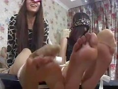 Two Chinese girl's feet tied and tickled