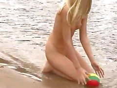These beach babes are running around on the beach naked in the sun