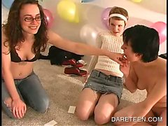 Aroused teens kissing in group sex games