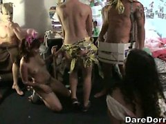Risika and friends get naughty at a no clothes party.