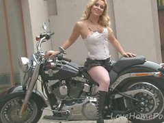 Hot girl on motorbike teases with her ass