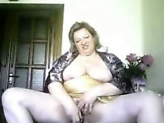 Granny housewife Sonja dildoing at home