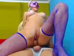 Blonde toys herself while getting fucked anally