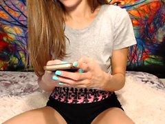 Cute brunette webcam babe pulls down her panties