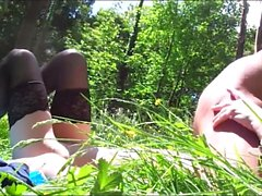 Horny lady in black stockings has sex with her lover in the outdoors
