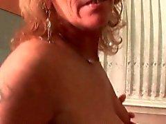 Mature hoe masturbating pussy in kitchen