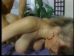 Blonde fucked in pussy and ass on the bed