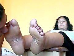 Serving her feet