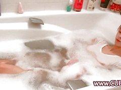 Busty brunette shaving her hole
