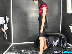 Slut masturbates in slime