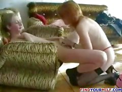Naughty redheaded mom seduces young boy and takes his cock in her twat