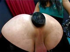 Brunette mistress Miss Jane is torturing her slave with butt plug