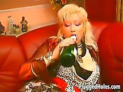 Busty MILF rides a bottle like crazy