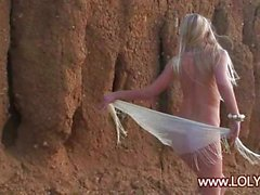 Blonde babe stripping on the beach