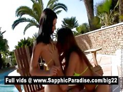 Naughty brunette lesbians kissing and licking nipples and having lesbian love