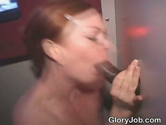 Awesome Looking Red Head Taking Facial Through Glory Hole