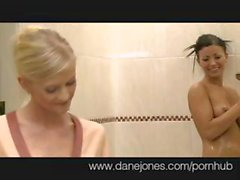 Two hot lesbians go at it in the shower and rub and lick pussy