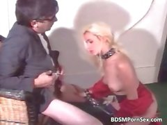 Attractive blonde bimbo sucks big white