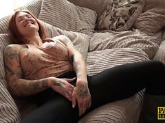 Inked submissive rubs her shaved pussy
