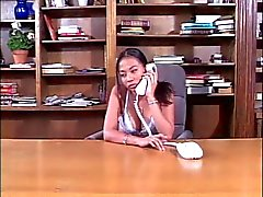 Asian hotties using a strap-on in the office