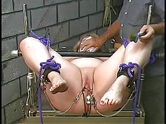 Candy gets tortured with clamps on her pussy lips and bound with ropes and cuffs