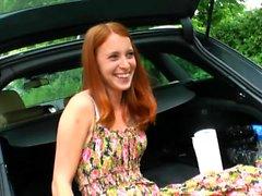 Petite redhead girl masturbates in her car