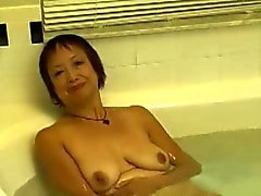 Horny Asian Granny Fucks her Cunt in the Hot Tube