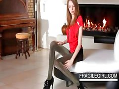 Teen temptress Gloria gets topless by the fire place