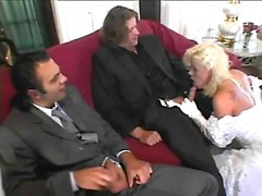 Lustful blonde peels off her wedding dress and gets nailed by two boys