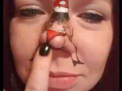 Dancing Santa on girl's nose