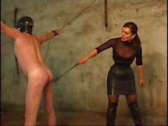 Brunette mistress is whipping her slave because he was bad