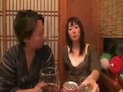 Asian cutie opens her mouth for a deep kiss at a drinking s