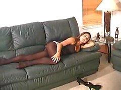 Brunette slut teasing in pantyhose