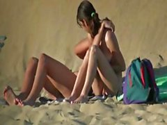Naughty nudists get caught on spy cam sunbathing at the beach