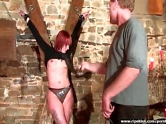 Redhead slut gets spanked by her master