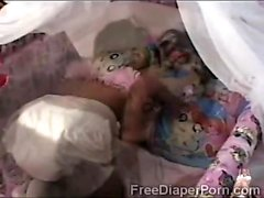 Petite Asian teen wears big diapers in this kinky solo