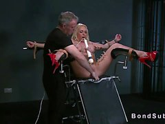 Strapped busty blonde in gyno chair pussy toyed