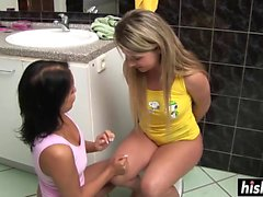 Sandra and Lisa scissor in the bathroom
