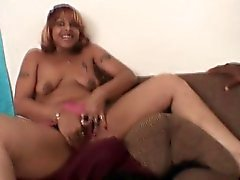 Two lusty porkers take turns pleasuring a horny cock in an ebony threesome