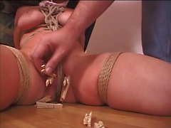 Babe bound on the floor and her pussy lips clamped