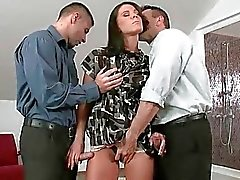 Hot young brunette riding two big cocks