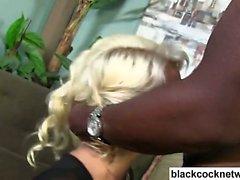 Bleach blonde choking on big black cock