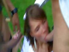 Brunette teen Megan is outside in a gangbang and bangs for a facial