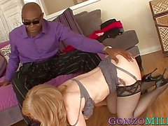 Busty MILF Nina Hartley facialized after riding black dick