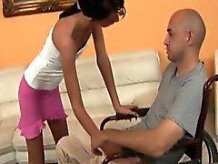 Petite brunette seduces and fucks guy in wheelchair